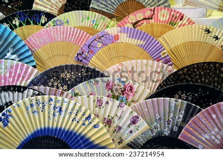 KYOTO, JAPAN-NOVEMBER 4, 2014; Set of Japanese Folding Fans at a shop and used overall in Asia. Selective focus at the front row. November 4, 2014, Kyoto, Japan  - stock photo
