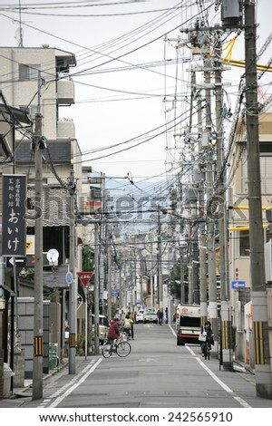 KYOTO,JAPAN-NOVEMBER 8, 2014; Street in old suburb with telephone poles and traffic.November 8, 2014 Kyoto, Japan - stock photo