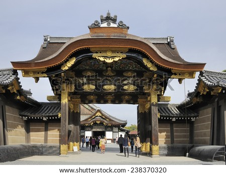 KYOTO, JAPAN - NOVEMBER 8, 2014: Tourists at the entrance gate of Nijo Castle. This an UNESCO World Heritage site and built in 1626. November 8, 2014 Kyoto, Japan - stock photo
