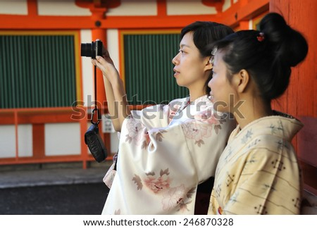 KYOTO, JAPAN - NOVEMBER 3, 2014: Two geisha's making a photo at the Enryaku-ji Temple. This is an Unesco World Heritage site.November 3, 2014 Kyoto, Japan  - stock photo