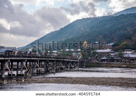 Kyoto, Japan - November 26,2015 :  Unidentified people visiting  Togetsu Bridge on the Oi river for tourist who travel to Arashiyama mountain area in Kyoto ,Japan.