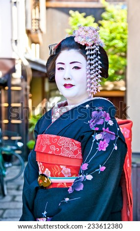 KYOTO,JAPAN-OCT 24,2014:Unidentified geisha on Oct 24,2014 , Kyoto,Japan. Apprentice geisha in western Japan, especially Kyoto.Their jobs consist of performing songs, dances, and playing the shamisen. - stock photo