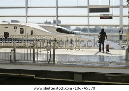 KYOTO, JAPAN - OCTOBER 23: On train station on October 12, 2012 in Kyoto, Japan. Passenger waiting to board the fast Shinkansen bullet train station.  - stock photo