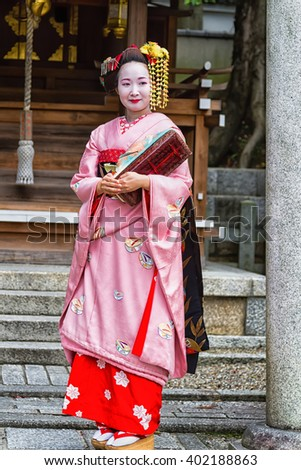 KYOTO - NOV 20, 2014: Young beautiful Japanese women called Maiko wear a traditional dress called Kimono on November 20, 2015 at Gion, Kyoto, Japan.