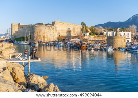 Kyrenia, Cyprus - March 23,2011 : People are fishing in the Kyrenia Marina. Kyrenia is populer tourist attraction in Cyprus
