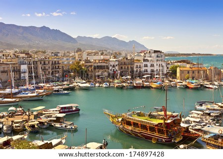 KYRENIA, CYPRUS - OCTOBER 6, 2013 - Scenic view of a busy historic harbour and the old town in Kyrenia (Girne) on the Island of Cyprus. - stock photo