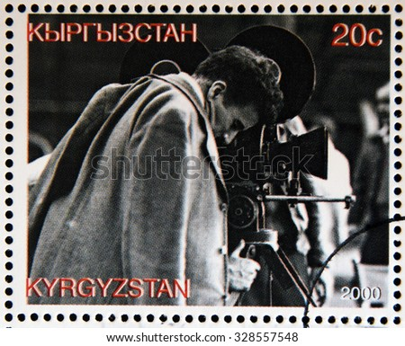 KYRGYZSTAN - CIRCA 2000: A stamp printed in Kyrgyzstan shows Charles Chaplin directing a film, circa 2000  - stock photo