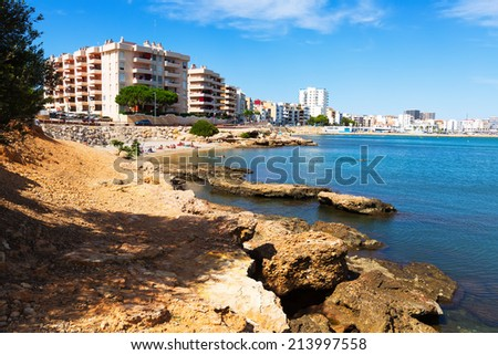 L'AMPOLLA, SPAIN - AUGUST 13, 2014: Coast at typical mediterranean town. L'Ampolla