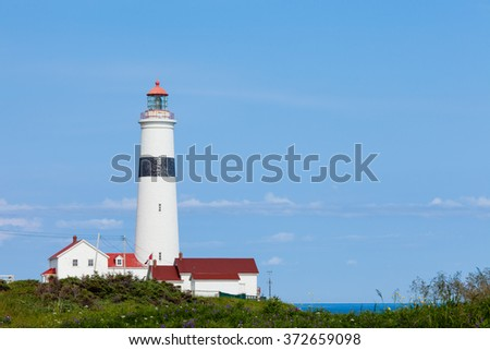 L'anse Amour Lighthouse at Strait of Belle Isle, Labrador, Canada - stock photo