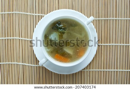 l cabbage soup - Green nettles and chicken wings - stock photo