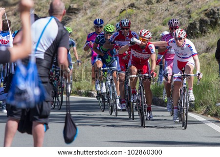 LA BARACCA, LA SPEZIA, ITALY - MAY 17: Cyclists taking supplies from their masseurs during the 12th stage of 2012 Giro d'Italia on May 17, 2012 in La Baracca, La Spezia, Italy - stock photo