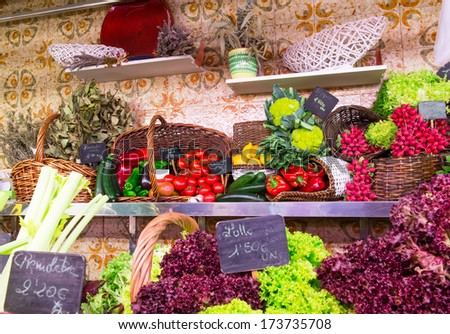 La Boqueria market with vegetables and fruits in Barcelona, Spain - stock photo