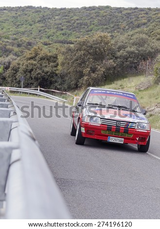 LA CABRERA, SPAIN - APRIL 25th 2015: Madrid rally championship. Alcides Pinho is driving his -Peugeot 205 Rallye-, during the ascent to -La Cabrera-, on April 25th 2015. He had to pull out of the race