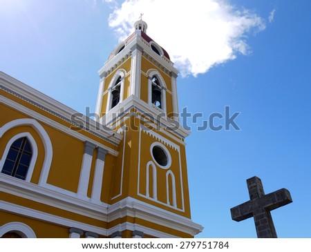 La Catedral de Granada, Low Angle View of Steeple with Cross Against Blue Sky, Granada, Nicaragua - stock photo