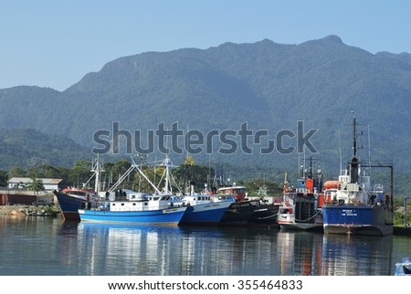 LA CEIBA, HONDURAS - JUNE 21, 2014: Commercial fishing and lobster boats in the harbor