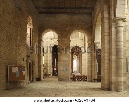 LA CHARITE SUR LOIRE, FRANCE - AUGUST 1, 2005: Interior of the church of Sainte-Croix-Notre-Dame. Church was listed as a UNESCO World Heritage Site, as part of the Routes of Santiago de Compostela - stock photo