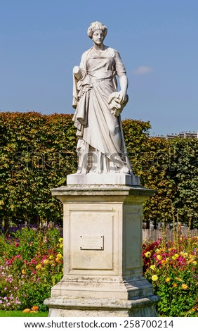 La Comedie. The comedy. Statue in Tuileries park, Paris, France. - stock photo