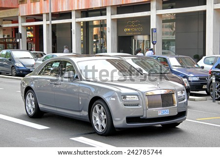 LA CONDAMINE, MONACO - AUGUST 2, 2014: Silver premium class saloon Rolls-Royce Ghost at the city street. - stock photo