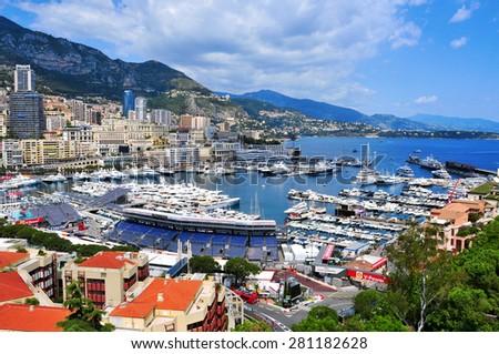 LA CONDAMINE, MONACO - MAY 16: Aerial view of the Port Hercules on May 16, 2015 in La Condamine, Monaco, during the preparations for the 73 Monaco Grand Prix, and Monte Carlo in the background - stock photo