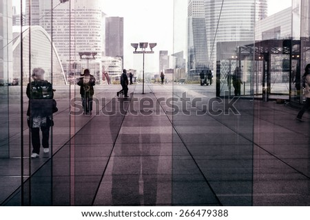 La Defense abstract background (Financial District in Paris) with unrecognizable commuters and tourists.