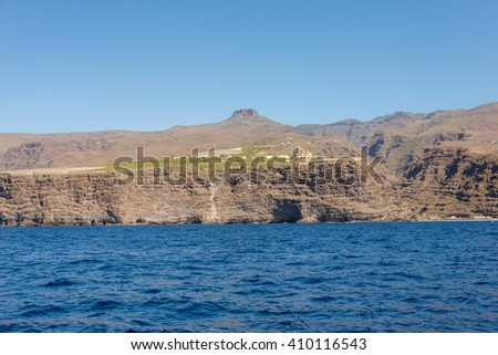 La Fortaleza on La Gomera. The mountain is a huge volcanic plug on the west side of the island. In the foreground the steep coast of the village La Dama known for agriculture and banana plantation