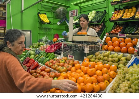 LA LAGUNA, TENERIFE - AUGUST 15, 2015: Woman buying fruit at a market stall in La Laguna, Tenerife.