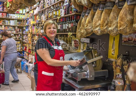 LA LAGUNA, TENERIFE, CANARY ISLANDS - DECEMBER 17, 2015: Woman in a sausage shop market town