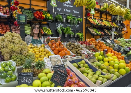 LA LAGUNA, TENERIFE, CANARY ISLANDS - DECEMBER 17, 2015: Woman in a store of fruits and vegetables , in the market town