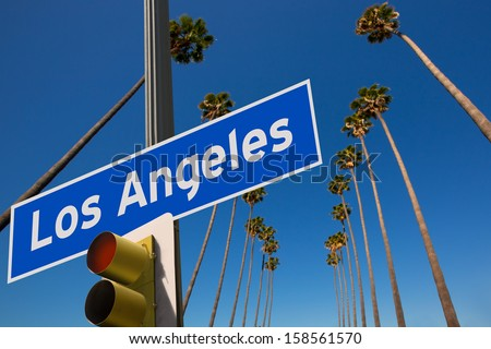 LA Los Angeles palm trees in a row typical California with road sign photo mount - stock photo