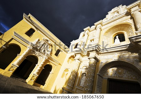 La Merced Church in Antigua. Seen late afternoon with dramatic sky. - stock photo