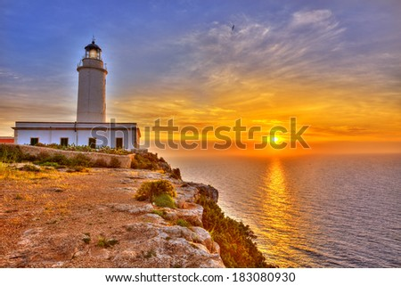 La Mola Cape Lighthouse Formentera at sunrise in Balearic Islands - stock photo