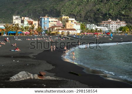 LA PALMA, CANARY ISLANDS, SPAIN - JANUARY 2006: Beach and promenade of Puerto de Tazacorte on La Palma, one of the Canary Islands, Spain - stock photo