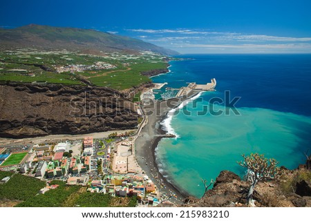 La Palma, Canary Islands, view from viewpoint Mirador el Time towards Puerto de Tazacorte with chirned up sand stain on the ocean - stock photo