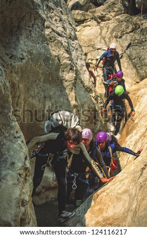 LA PALUD, FRANCE - AUGUST 24: Unindentified guide leads a group through a narrow canyon in Gorge du Verdon on August 24, 1999. The gorge is popular with rockclimbers and kayakers.