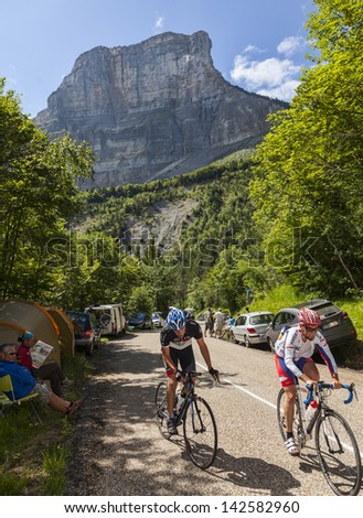 LA PALUD,FRANCE,JUL 13:Amateur cyclists climbing the road to mountain pass Granier in the Alps before the passing of the peloton in the 12 stage of the Le Tour de France on July 13 2012 in La Palud - stock photo