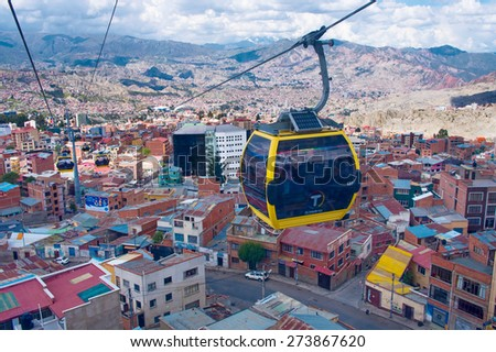 LA PAZ, BOLIVIA - APR 03, 2015: Cable cars carry passengers in La Paz. Aerial cable car of urban transit system opened in 2014 in the Bolivian city of La Paz. - stock photo