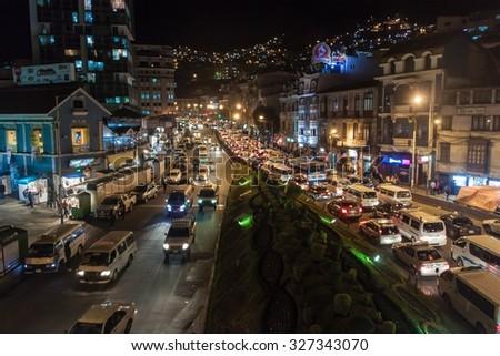 LA PAZ, BOLIVIA - APRIL 28, 2015: Traffic on a main road Avenida Ismael Montes in La Paz, Bolivia. - stock photo