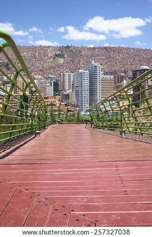 LA PAZ, BOLIVIA - OCTOBER 14, 2014: Pedestrian Via Balcon (Balcony Path) leading over Parque Urbano Central (Central Urban Park) with view of the city on October 14, 2014 in La Paz, Bolivia   - stock photo