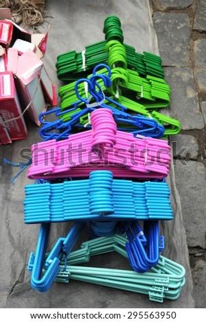 LA PAZ, BOLIVIA - SEPTEMBER 5, 2010:Hangers for clothes on the market of La Paz.  - stock photo