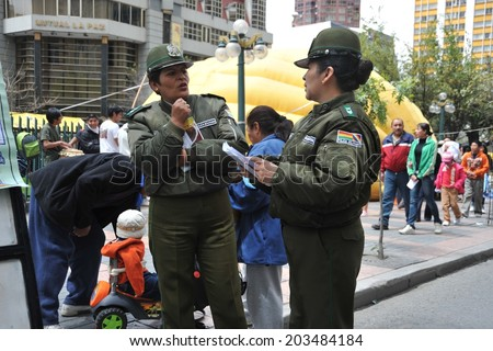 LA PAZ, BOLIVIA - SEPTEMBER 5, 2010: Large high city and actual capital in the Central part of South America. The majority of the population lives in poverty. Police on a city street.