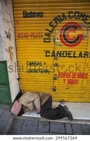 LA PAZ, BOLIVIA - SEPTEMBER 12, 2010: Large high city and actual capital in the Central part of South America. The majority of the population lives in poverty. Homeless on the streets of La Paz. - stock photo