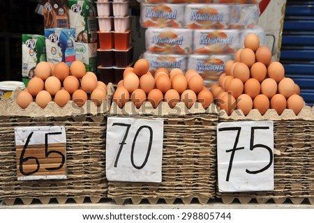 LA PAZ, BOLIVIA - SEPTEMBER 5, 2010:Trading eggs on the streets of La Paz. The actual capital of Bolivia, where most of the state institutions. - stock photo