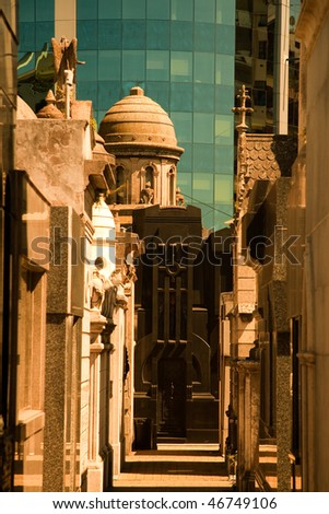 La Recoleta contrasts impeccable mausoleums with crumbling marble tombs. - stock photo