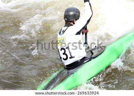 LA SEU D'URGELL, CATALONIA - MARCH 22: Unidentified sports people struggling with the flow. ICF Canoe Slalom training 22 March 2015 in La Seu d'Urgell, Catalonia. Parc Olimpic del Segre - stock photo
