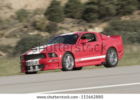 LA SEU D'URGELL, SPAIN - OCTOBER 7: A Ford Shelby Cobra GT500 take part in Road and Track racing weekend organized by American Car Club, on October 7, 2012, in La Seu d'Urgell, Spain.