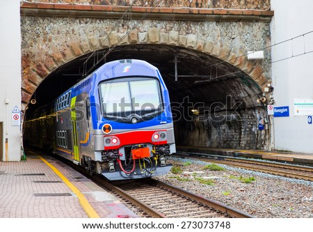 LA SPEZIA , ITALY - MARCH 17, 2015: High speed train driving out from tunnel  - stock photo