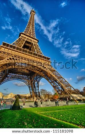 La Tour Eiffel - Beautiful winter day in Paris, Eiffel Tower from Champs de Mars - France - stock photo