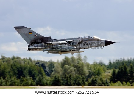 LAAGE, GERMANY - AUG 23, 2014: A German Air Force Panavia Tornado IDS from AG-51 takes off during the Laage airbase open house. AG-51 is a tactical reconnaissance wing of the German Air Force. - stock photo