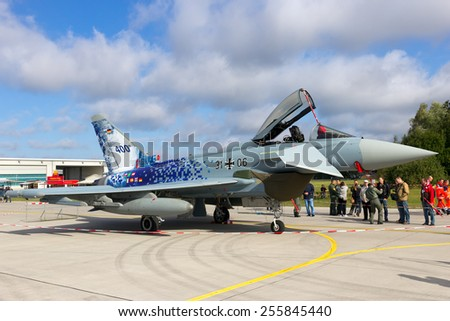 LAAGE, GERMANY - AUGUST 23, 2014: A German Air Force Eurofighter Typhoon on display during the Laage airbase open house. The aircraft is the 400th build Eurofighter. - stock photo
