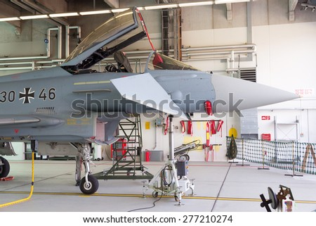 LAAGE, GERMANY - AUGUST 23, 2014: German Air Force Eurofighter Typhoon fighter jet in a hangar during the Laage airbase open house. - stock photo